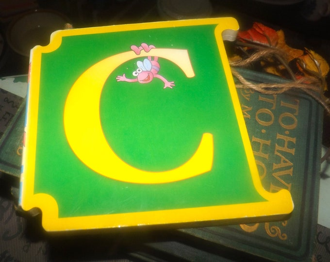 Vintage (1996) CTW Sesame Street Letter C: C is for Cookie interlocking book. ABCs Muppets Cookie Monster Reader's Digest Young Families.