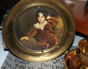 Early mid-century (1940s) brass-framed picture of Sir Thomas Lawrence The Red Boy. Frame marked Brass made in England to reverse.