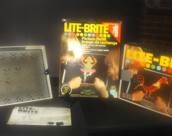 Vintage (1980s) Classic Hasbro Lite Brite toy. Original box, 32 paper design refills, instructions. Tested, functioning but without pegs.