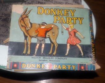 Quite vintage (1933) Donkey Party | Pin the Tail on the donkey party game 4920 by Milton Bradley.  Made in USA.  Complete.