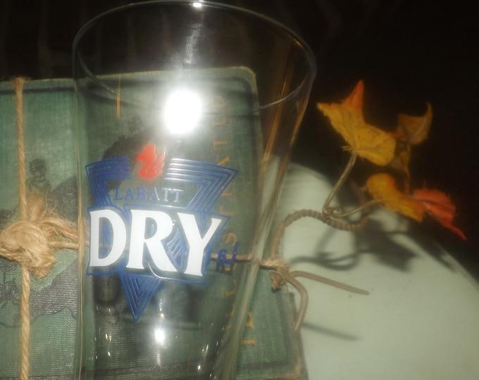 Vintage (1990s) Labatt Dry La Catcher   Labatt Breweries Canadian tapered pilsner beer glass. Etched-glass artwork, logo.