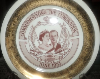 Mid-century (1953) Queen Elizabeth II Coronation plate made by Georgian China USA. Broad gold band, central portraits. Flawed (see below)