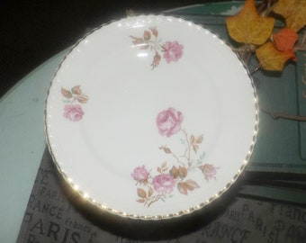 Almost antique (1920s) Johnson Brothers Miniver Rose hand-decorated bread-and-butter, dessert, or side plate. Old English ironstone. Flawed.