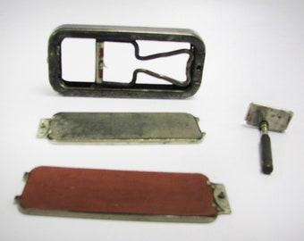 Almost antique (1927) Vintage Rolls razor in embossed metal travel case.  Great man gift.