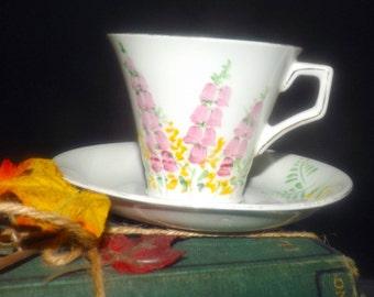 Quite vintage (1930s) Radfords Fenton hand-painted art-deco tea set (flat, corset-shaped cup with saucer). Pink delphinium, yellow florals.