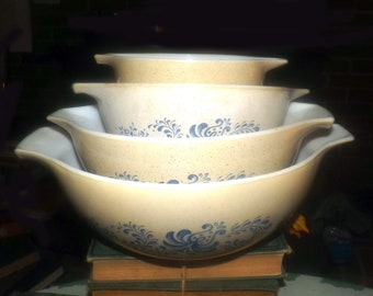 Set of 4 vintage (1970s) Pyrex Homestead Pattern cinderella bowls. Blue stenciled florals on brown.  Retro kitchen delight.