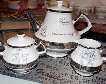 Mid-century (1950s) Gibsons Gibson & Sons 25th Anniversary Platinum teapot, creamer or covered sugar bowl. Cherubs, wedding bells.