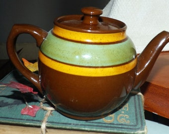 Late mid-century (late 1950s) Sadler Brown Betty mini redware teapot with lid. Olive green and mustard stripes.