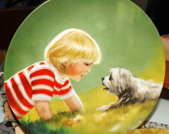 Pair of vintage (1980s) limited edition, signed plates by Pemberton & Oakes. Children and Pets collection plates 1 and 3.
