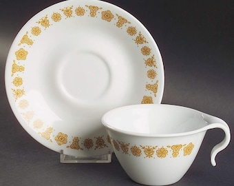 Vintage (1970s) Corelle | Corning USA Butterfly Gold hangable cup with matching saucer. Hook handle, yellow floral border. Made in USA.