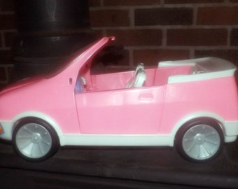 Barbie's pink convertible car made by Hasbro.  Barbie license plates, doors open and close. Retired 1999.