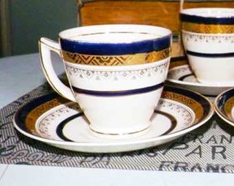 Art-deco (1930s) Myott Royal Crown The Crowning Cobalt demitasse espresso | cappuccino | cup and saucer. Encrusted gold.