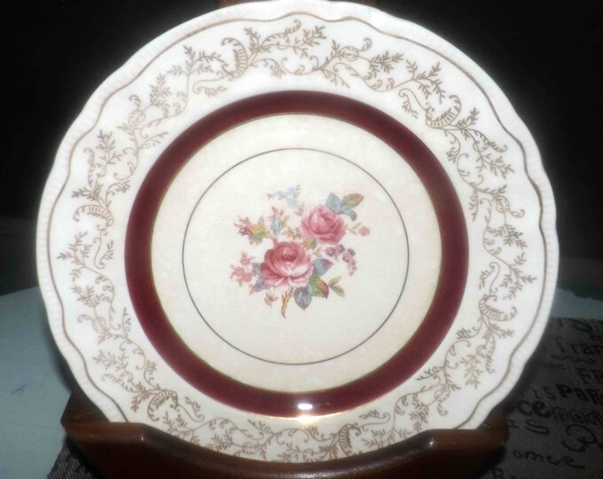 Early mid-century (1940s) Sovereign Potters Montcalm salad or side plate. Lavish maroon, gold bands, center florals, filigree. Flawed.