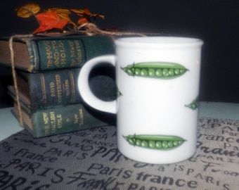 Vintage (1980s) Danesco coffee | tea mug features green peas in their pods on a white ground. Decorated in Canada.