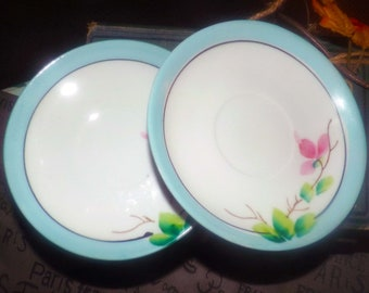 Pair of antique (1910s) hand-painted Nippon lusterware orphan saucers only. Pink florals, branches, blue and gold bands, white center.