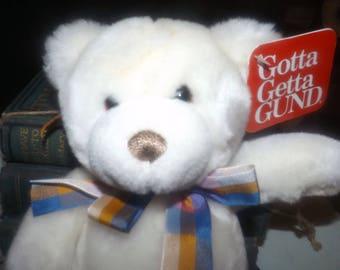 Vintage GUND Snugwell 2356 small, soft, white plush teddy bear with plaid bow and original GUND tags.