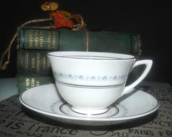 Mid-century (1950s) Royal Doulton Tiara H4915 tea set (footed cup with saucer). Blue-grey vines and leaves, platinum edge and bands.