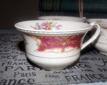 Early mid-century (mid 1940s) Simpsons Potters Rosita orphan tea cup. 18-karat gold rope edge, florals, maroon bars. Ambassador Ware.