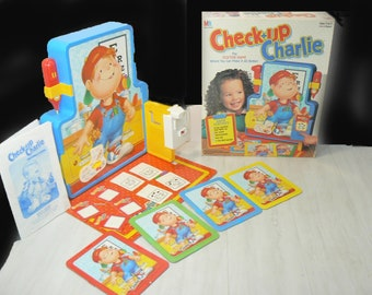 Vintage (1995) Check-Up Charlie board game published by Milton Bradley. Complete.