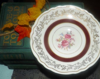Early mid-century (1940s) Sovereign Potters Montcalm pattern orphaned saucer (NO cup). Maroon, gold bands, florals, filigree.