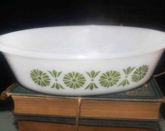 Vintage (1960s) Glasbake | Jeannette USA JEG33 pattern 1-quart oval lugged, open casserole. Green florals, fans, dots on white.