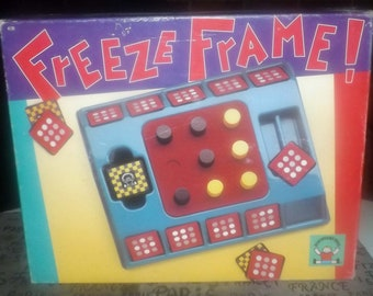 Vintage (1992) Freeze Frame board game published by Discovery Toys.  Pattern-matching game. Fun for all ages. Complete.