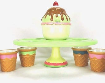 Vintage Boston Warehouse Ice-Cream Spinner Set. Ice-cream cone bowls, spinning stand with center bowl and lid. Flawed.