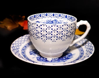 Early mid-century (1940s) Empire Porcelain Beverley Blue cup and saucer set made in England. Blue-and-white florals. urns.