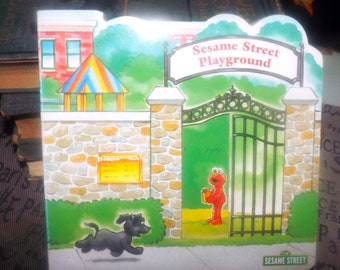 Sesame Street Playground children's hardcover board book printed in Italy | Italy import. Reader's Digest Young Families series. Complete.