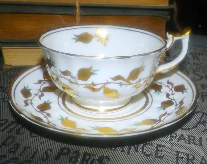Early mid-century (1940s) Royal Chelsea hand-painted teal and golden florals and leaves tea set (footed, wide-mouth cup with saucer).