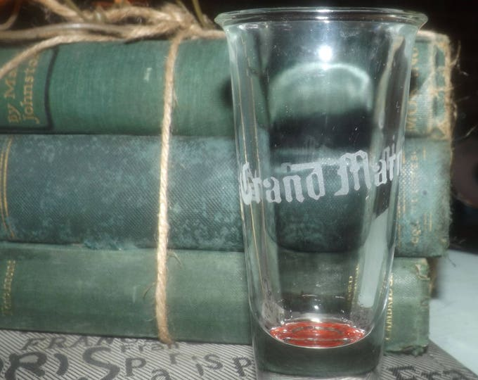 Vintage (late 1980s) la vie de Grand Marnier shooter glass.  Etched-glass logo, etched-glass base, weighted base, commercial quality.