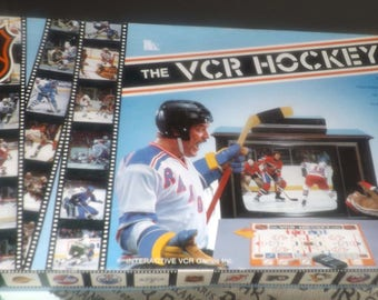 Vintage (1987) The VCR Hockey Game published by Interactive VCR Games. Endorsed by the NHL. Complete.