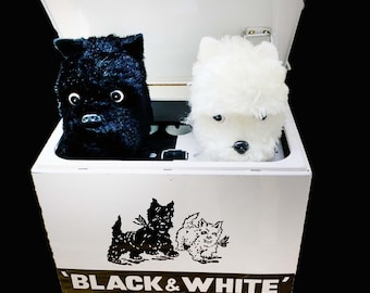Vintage (1960s) Black and White Scotch Whisky jack-in-the-box black and white terrier dogs advertising display unit. Made in USA.