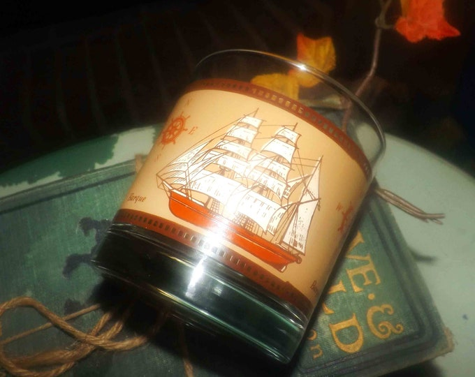 Mid-century (1950s) lo-ball   whisky   old-fashioned   on-the-rocks glass.  Gold etched barque   sailing ship, weighted base.