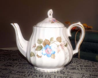 Vintage (1980s) Sadler Windsor line teapot.  Blue flowers with pink center, green and brown leaves, gold edge and accents.