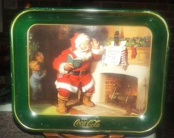 Vintage (1989) Coca-Cola metal Christmas Tray. Santa Claus checking his Good Boys & Girls list, twice!