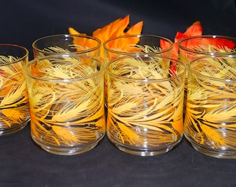 Set of seven vintage (1970s) Libbey Golden Wheat 6-ounce juice glasses. Etched-glass wheat sheaves. Made in the USA.