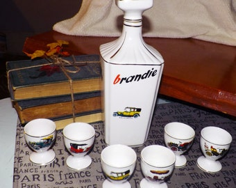 Mid-century (1950s) Alfal Alcobaca Portugal hand-painted decanter set featuring antique cars.