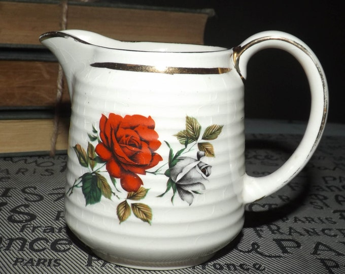 Early mid century (1940s) Sadler 3635 hand-painted creamer.  Red and white rose blooms, pops of greenery gold edge + accents, ribbed body.