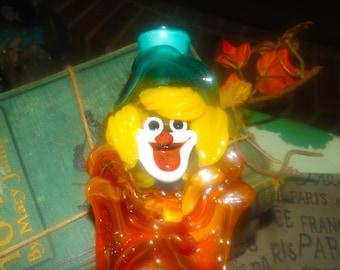 Mid-century (1950s) Murano art-glass hand-blown clown figurine.  Grafitti colors, red and orange glass bow.