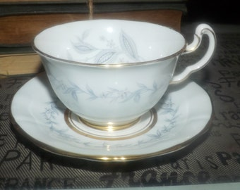 Mid-century (1950s) Northumbria AG Morning Mist hand-painted tea set (footed cup with saucer). Blue-grey leaves and flowers, gold edge.