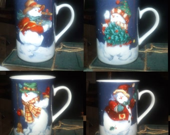 Set of 4 Christmas coffee or tea mugs. Snowmen. The Edith Collection by Mary Parker. Made for Sears in Canada.