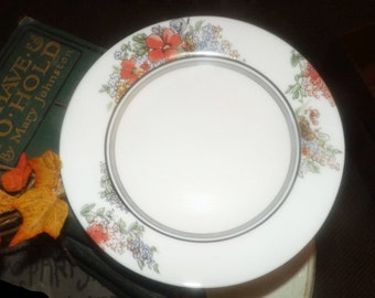 Vintage (1980s) Arcopal France glass salad or side plate. Orange and blue flowers, black and grey bands on white.