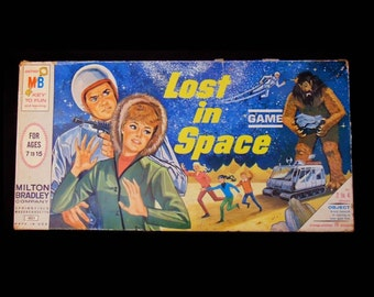 Vintage (1965) first-edition Lost in Space board game published by Milton Bradley. Complete. Made in USA.