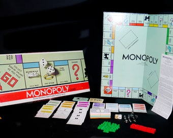 Vintage (1961) Monopoly board game published by Parker Brothers. Complete with original instructions, metal player pawns.