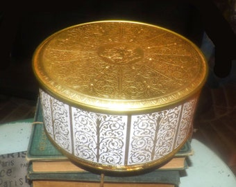 Vintage (1970s) Guildcraft round fancy tin for cookies, vanity, photos. Embossed gold fruit and white scrolls. Made in USA.