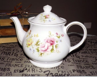 Vintage (1970) Sadler floral teapot with a gold edge and accents.  Pink and yellow roses, multicolor flowers.