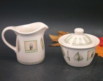 Vintage (1997) Pfaltzgraff Naturewood stoneware creamer and covered sugar bowl.
