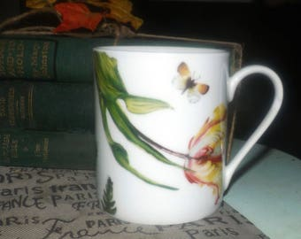 Royal Worcester Floral Haven pattern coffee or tea mug. Vivid florals, leaves and butterflies.
