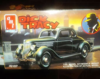 Vintage (1990) AMT | ERTL Dick Tracy Ford Coupe car model kit #6107.  Complete in factory-sealed packaging. Made in USA.